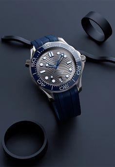 Blue combines beautifully with the PVD chrome-colour dial of this Seamaster Diver watch. Lux Watches, Casual Watches, Vintage Watches, Amazing Watches, Cool Watches, Watches For Men, Omega Seamaster Diver 300m, Omega Speedmaster, Omega Seamaster Professional