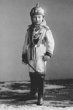 misshonoriaglossop:  A little Prussian girl with a spiked helmet, sword and swagger-stick, fitted out like a Sergeant of the cavalry. It was usual that children posed in uniforms in the Imperial Era.