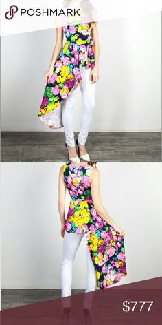 Trendy floral top Brand new with tags  Boutique item, price is firm   Beautiful and feminine floral top featuring peplum detail that flows longer on 1 side. Pair with white pants/jeans and heels.  97%rayon 3%spandex  Multi color Tops