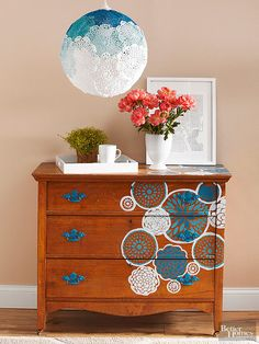 If you don't want to paint a wood dresser completely but still want to give it a little oomph, consider stenciling.