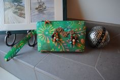 """This adorable batik print also features jute twine, and ceramic and wood beads. """"A Little Birdie Told Me"""" was a custom order for an environmentally conscious lady so I tried to keep it as organic as possible.  Mystified by the name?  Hop on over to Bobbin My Thread on Facebook to solve that mystery!"""