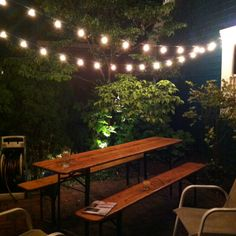 string lights across back brick walk area - attach them to boat shed