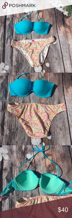 VS swimsuit bikini Solid light blue top. Hooks on back with three different loops for adjusting  and ties around neck. Bottoms are multi  bright colored. Absolutely beautiful in perfect condition. Brand new and never worn. Top is 34 D and Large bottoms Victoria's Secret Swim Bikinis