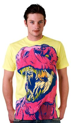 DINO FRENZY T-shirt by MR-NICOLO from Design By Humans. There's no question this T rex shirt comes with a bite. Dino Frenzy takes the tough T Rex and puts him in the retro neon fashion. The neon pink rex jumps out of the shirt ready to scream to the fashionably loud human world. Some say fresh, some say pop, the rex says raaaawwwrrr!! for $22