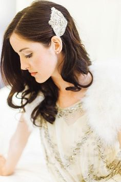 Soft waves accented with a vintage hairpiece and a veil | @stephanielyell | Brides.com