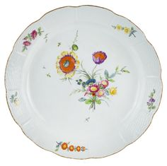 A CHARGER FROM THE EVERYDAY IMPERIAL SERVICE, RUSSIAN IMPERIAL PORCELAIN FACTORY, ST. PETERSBURG, PERIOD OF CATHERINE II (1762-1796) in the Meissen Old Ozier pattern, the scalloped edges with a basket-weave design, the cavetto and the edges with spays of wildflowers, diameter: 39 cm (15 3/8 in.), underglazed Imperial Cypher of Catherine II on base
