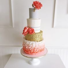 absolutely loving this cake! this four tier coral and grey beauty was a pleasure…