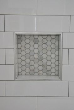 Looking to upgrade your bathroom shower? See how we used elongated white subway tile with dark gray grout and marble hex tile niche. Looks super luxe but on a budget! Click through for all the details. White tile with dark gray grout vs white grout Hall Bathroom, Upstairs Bathrooms, Bathroom Renos, Bathroom Flooring, Bathroom Ideas, Master Bathroom, Budget Bathroom, 1930s Bathroom, Small Grey Bathrooms