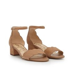 Our Inara Scalloped Block Heel Sandal is both professional and fun. With scalloped edges and its trendy ankle strap, it plays many parts. Wear it from a ladies' lunch to a casual girls' night out. Scalloped Ankle Strap Block Heel SandalClosure: Ankle strap buckleToe: OpenHeel height: 1 inchMaterial: LeatherInsole: Synthetic
