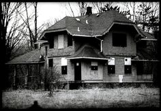 One of the abandoned houses at 'Demon's Alley,' a classic spot from Weird NJ magazine. Note the shades that have been painted on the boarded up windows.