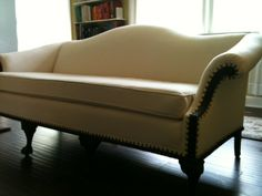 Camel Back sofa reupholstered in canvas