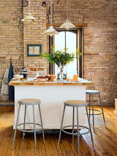 The owner of this loft crafted a kitchen island from an old cabinet, which she topped with wooden packing crate slats.