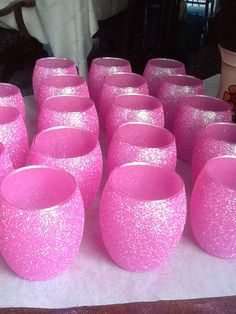 Glitter candles - Elmer's school glue, a small sponge brush, and Tulip's Neon Pink fabric glitter.  Soooooo pretty!!