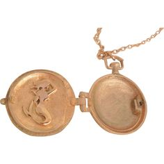 Rare Art Nouveau early 1900's Locket is beautifully crafted and in excellent condition. Shaped like a pocket watch the front has raised etched flowing