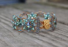 Hand Beaded Bracelet with Swarovski Rivolis Crystals by pjlacasse