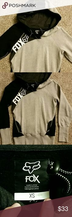 Fox hoody/sweatshirt Perfect condition!! Tried to wear it twice, but i recently had a baby and now wear a size small. Super super comfy, black and grey, Fox sweatshirt. Size XS. Black/grey/dark grey hood with adjustable drawstrings. Inside is soft thin fleece. Kangaroo pocket. Its not bulky but it's warm and cozy. Sleeves are long enough to not have bare wrists when u move around which I like. And the hood is roomy. only selling cuz it's too small. :( smoke/pet free environment. I consider…