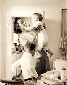 Ethel with baby Michael LeMoyne Kennedy and Bobby Jr. - 1958  Mother of 7