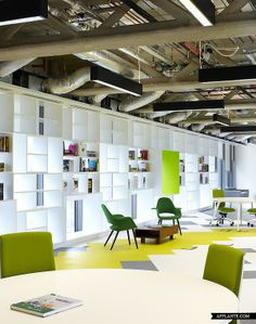 Design Studio HQ by Archer Architects- making the most of natural daylight to backlight the shelving system.