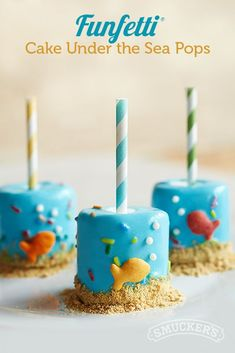 What a cute idea for an under-the-sea-themed birthday or summer party. Coat marshmallows with Smucker's® Magic Shell® Funfetti® Vanilla Cake Flavored Topping, and add fish-shaped crackers, graham-cracker crumbs, and sugar pearls. Graham Cracker Crumbs, Graham Crackers, Marshmallows, Sea Cakes, Funfetti Cake, Cake Flavors, Dessert Recipes, Desserts, Under The Sea