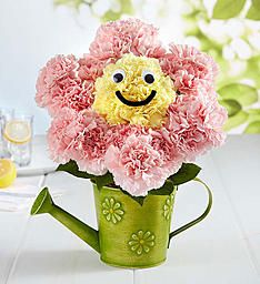 Happiness Blooms   1800Flowers.com   Our new, playful 3-D design will have smiles popping up everywhere! Handcrafted from sweet pink & yellow carnations in the shape of a daisy—complete with a playful grin and googly eyes—this totally fun, truly original 3D arrangement arrives inside our charming green watering can, featuring an embossed daisy design.