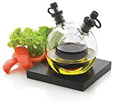 Featuring an innovative design, the Orbit Oil and Vinegar Set is a stylish mouth blown glass globe which can hold both oil and vinegar for your salad needs.