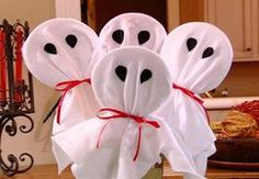 How cute for a fun center-piece. These are large lollipops covered in white felt or any white fabric with black felt eyes.  Use as a center piece then give out to those SPECIAL trick or treaters.