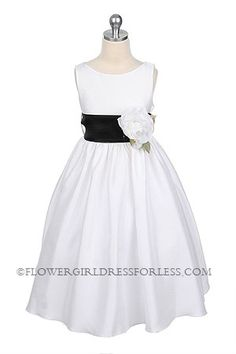 black sash with ivory flower might be nice.. you can get like any color under the rainbow