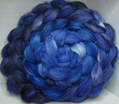 Gorgeous shades of Royal Blues in gradient style.  This base being organic polwarth is very white and with the cultivated silk its gloriously bright to paint dyes on. The silk shows as a bit streaky in the colors but it is very well incorporated and spins like a dream. I forsee this becoming very much a favorite around Chez Corgi.=  ---- The Fiber and Yarn at Corgi Hill Farm that is hand dyed by me means variations between dyelots done on different days are probable. Please be sure to get…