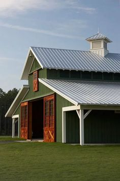 Metal Barn: Which is Better Deciding the correct way to build a barn will be entirely dependent upon what you plan on using it for. Choose Wood Barn if you want better insulation and metal barn if you want durability. Metal Building Homes, Building A House, Building Art, Metal Homes, Barn With Living Quarters, Design Garage, House Design, Green Barn, Barns Sheds