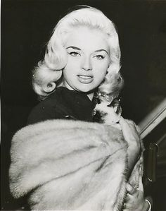 Diana Dors and sleepy cat.  Of course she would have a Siamese!