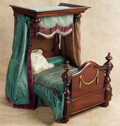 Very Fine French Wooden Doll Bed with Silk Curtains. Circa 1875.