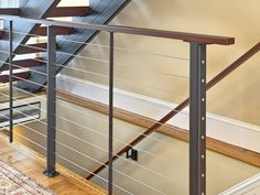 A modern floating staircase and thick Brazilian cherry wood treads with sleek stainless steel cable railing and powder coated steel posts in Katonah, NY. Staircase Landing, Floating Staircase, Staircase Design, Brazilian Cherry Wood, Stainless Steel Cable Railing, Steel Stairs, Rail Fence, Entryway Tables, Cool Photos