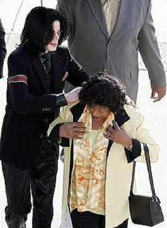 So sweet! MJ helping mother.