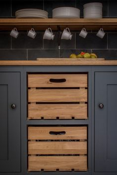 Two of the drawers in this space from Sustainable Kitchens are wood crates, perfect for storing produce