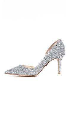 Allover glitter shimmers on these pointed-toe Badgley Mischka pumps. Covered heel and leather sole.