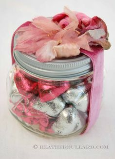 One of my favorite things to do is repackage! Take a simple bag of Valentine chocolates, fill a small mason jar and top with scrap piece of velvet ribbon and an old millinery flower.