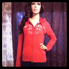 Reddish Orange Zip Up Cozy Hoodie Photos are taken in the best possible lighting available to me. Although color may be lighter than pictured. I work hard on these listings to give you an idea of what this garment will look like when worn and styled. Most everything is gently used in pre-owned condition, at the bottom of each listing will be a few notes about the individual item. Ask me any questions! *Super cozy! Great condition. Hollister Tops Sweatshirts & Hoodies