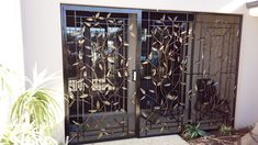 Beautiful eucalyptus marri design iron door and side portico entry.  Secure your space with our 10-point security features.  Artwork made from recycled steel and finished with auto-grade paints.