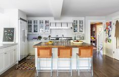 statement stools in an all white kitchen
