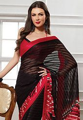 An endearing splash oh colors look gorgeous tridimensional charm. This black and red georgette saree is nicely designed with geometric print work. Saree gives you a singular and dissimilar look. Matching red blouse is available. Slight color variations are possible due to differing screen and photograph resolution.