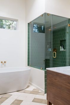 Love the green bathroom tile and gold accents