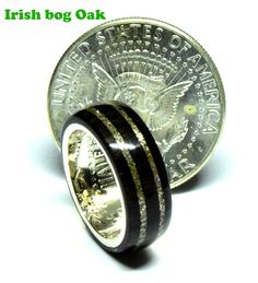 Celtic Irish bog Oak wedding rings with silver half dollar coin Coin Ring, Irish Celtic, Dollar Coin, Half Dollar, Unique Colors, Wedding Ring Bands, Two By Two, Coins, Rings For Men