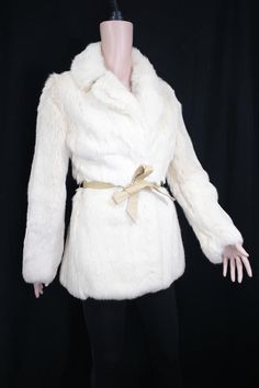 Vintage creamy  rabbit fur coat c.1970. Perfect for winter and vintage bridal wearCondition: Very goodSize: S / UK 8-10 / US 4-6Details- Beautiful cream rabbit fur coat - Soft and supple fur- Classic timeless shape with a slight defined waist when fastened- Fastens with two furrier hook snaps- Two external pockets - Comes with leather belt. There are belt loops - Fully lined with pink silky fabric- Perfect for winter and vintage bridal wearMeasurements:Length: 27.5 inches / 70 cm (hip length… Vintage Fur, Vintage Bridal, White Fur Coat, Rabbit Fur Coat, Winter Fur Coats, Mens Fur, Fur Wrap, Vintage London, Autumn Fashion