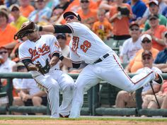 Baltimore Orioles infielder Everth Cabrera, left, and first baseman Steve Pearce collide as they go for a pop fly in the fourth inning of the spring training game against the Toronto Blue Jays in Sarasota, Fla.  Jonathan Dyer, USA TODAY Sports