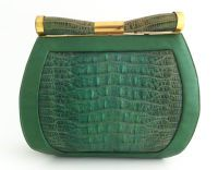1930's Art Deco Saks Green Lizard Purse USA  Vintage 1930's Art Deco green purse by Saks Fifth Avenue. Leather, brass, and lizard skin. Beautiful cylindrical clasp accented with brass, and small interior change purse.