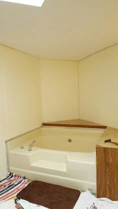 Redesigning our master bathroom. Before pics of the tub area. Flooring had just been removed.