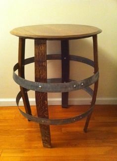 Wine Barrel Table, maybe one barrel in the corner behind the bar, as a side table