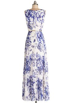 When your family takes you out for a celebration, this beautiful blue floral maxi dress helps complement the peaceful, pretty scene. Wrapped in this dress, its light-gold belt, a pastel cardi, and gilded gladiators, you take in the gorgeous setting. Big blue blooms, silky lining, and a flowing chiffon overlay come together to make this dress something worth celebrating!