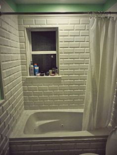 Shower Surround And Wainscoting Made Of White 4x8 Bevel Subway Tile By Cobsa .