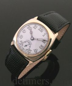 A 9ct gold cushion vintage Longines watch, 1943